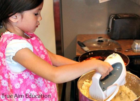 whipping garlic mashed potatoes