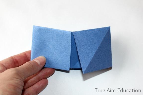 folding a paper fortune teller in half
