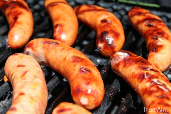 American Craft sausages grilling