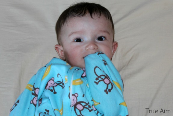 sucking fingers in sleep sack
