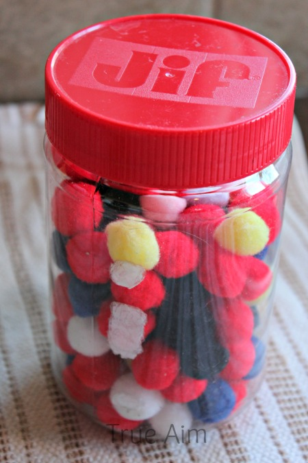 Reuse peanut butter containers for craft supplies